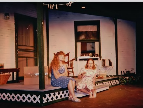 Elizabeth and Hattie, gossiping on the front porch. Look up and you'll see the laundry line!